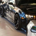 Car crashes into new Camaro z28 on shown room floor (1)