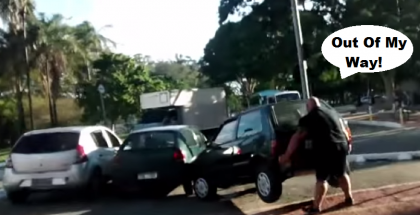 Cyclist moves car out of his way with muscle power 1