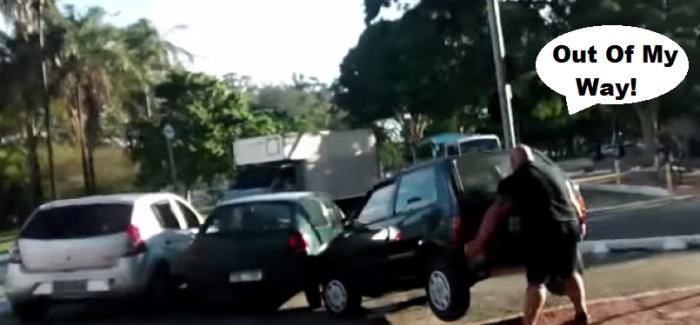 Cyclist moves car out of his way with muscle power – Video
