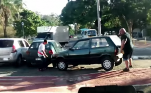 Cyclist moves car out of his way with muscle power 2