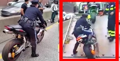 Lady cop drops motorcycle trying to impound it (1)