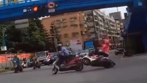 Scooter crash at intersection - Girl just takes of on red light 1
