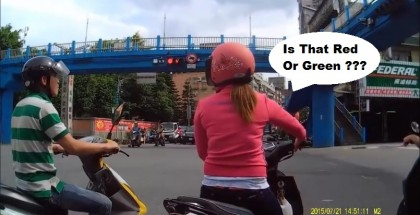 Scooter crash at intersection - Girl just takes of on red light 3