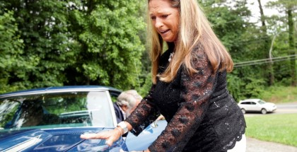 Allstate customer Terry Dietrich touches her 1972 Corvette Stingray for the first time in nearly 43 years. It was stolen from her just six months after she purchased the car in 1972.
