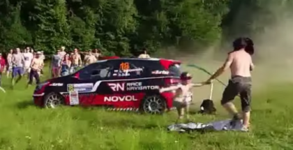 Rally car almost takes out crowd in slow motion 2
