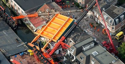 Two Giant Cranes Collapse Onto Houses (1)