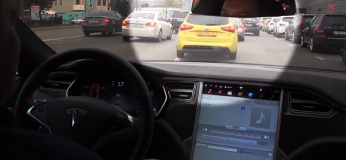 Tesla auto pilot avoids taxi cutting it off – Video