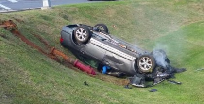 Woman does donuts in intersection ends flipping car (2)