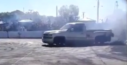 Donut burnout contest Chevy truck slams the wall gets the rear destroyed (1)