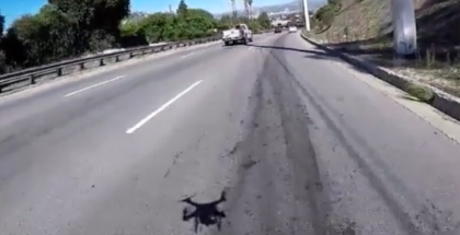 Drone crashes but then gets lucky while filming cars on the road - Video (1)