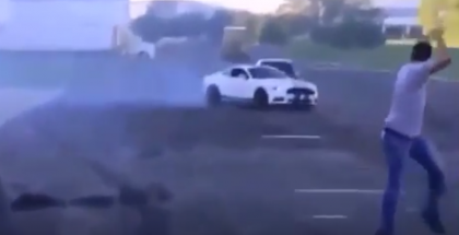 Mustang street race fail almost takes out other car (1)