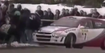Rally car driver makes sure spectators are not standing to close to the racers (1)