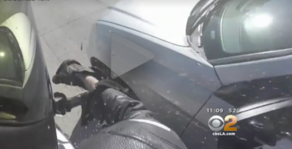 Road Rage Motorcyclist shatters mirrors on cars on the highway (1)