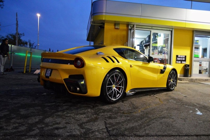 Yellow Ferrari F12tdf photographed at a gas station near