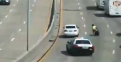 Cop car smacks the freeway wall while chasing suspect on motorcycle (1)