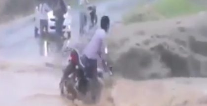 Going across a bridge on a motorcycle during a flood does not go well (1)