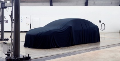 Tesla Model 3 with a cover waiting for tonight unveiling