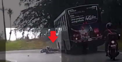 Close Call motorcycle rider almost run over by bus (1)