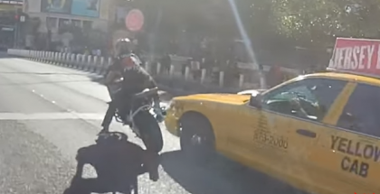 Motorcycle stunter close call with a taxi on Las Vegas strip (1)