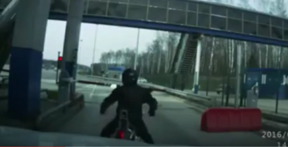 Woman driver in BMW X5 rams motorcyclist from behind while at toll stop (1)