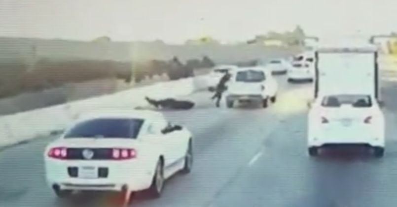 Crazy Motorcyclist Jumps Into Truck Bed After Road Rage