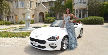 """LOS ANGELES, CA - MAY 11:  2016 Playmate of the Year Eugena Washington poses with her new All-New 2017 Fiat 124 Spider at Playboy's 2016 Playmate of the Year Announcement at the Playboy Mansion on May 11, 2016 in Los Angeles, California.  (Photo by Charley Gallay/Getty Images  for Playboy)"""