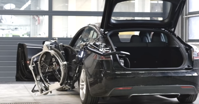 Electric Mini Cooper >> Robot arm in a Tesla Model S helps disabled with their ...