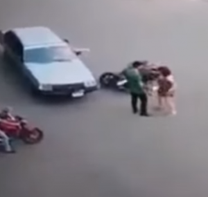 Super woman riding scooter hit by a car then gets a hug (1)
