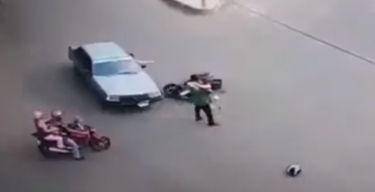 Super woman riding scooter hit by a car then gets a hug (2)