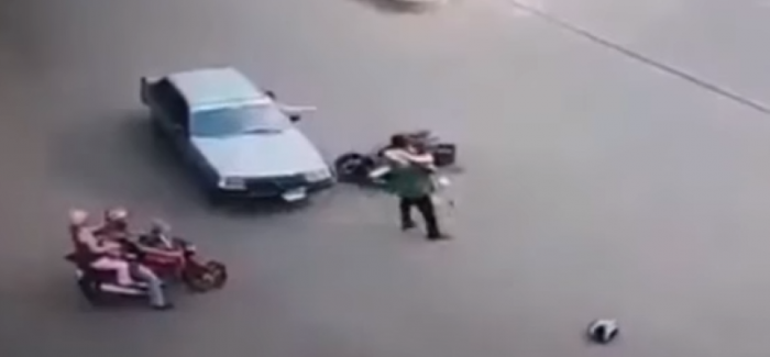 Super woman riding scooter hit by a car then gets a hug – Video