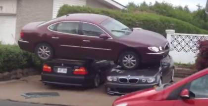 Buick parked on top of two BMW's (1)