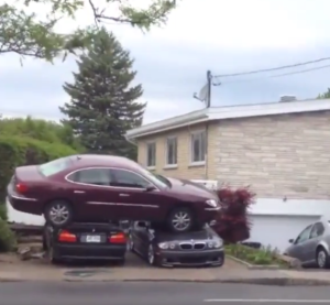 Buick parked on top of two BMW's (2)