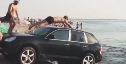 Porsche Cayenne used as a water slide and diving board (1)