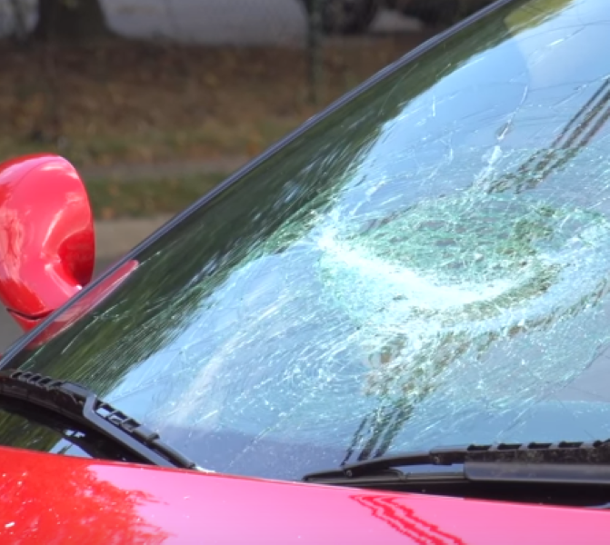 Destroying A Ferrari Windshield With A Baseball Bat