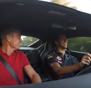 Daniel Ricciardo and David Coulthard going to work in an Aston Martin V12 Vantage S (2)