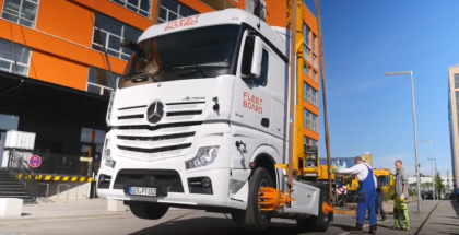 Putting a Mercedes Semi Truck On A Building Roof (1)